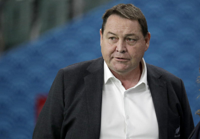 FILE - In this Oct. 2, 2019, file photo, All Blacks coach Steve Hansen watches his players warm up ahead of the Rugby World Cup Pool B game at Oita Stadium between New Zealand and Canada in Oita, Japan. Of the eight teams remaining in the Rugby World Cup four are coached by New Zealanders who, from similar beginnings, pursued divergent coaching careers before their paths intersected at this tournament. (AP Photo/Aaron Favila, File)