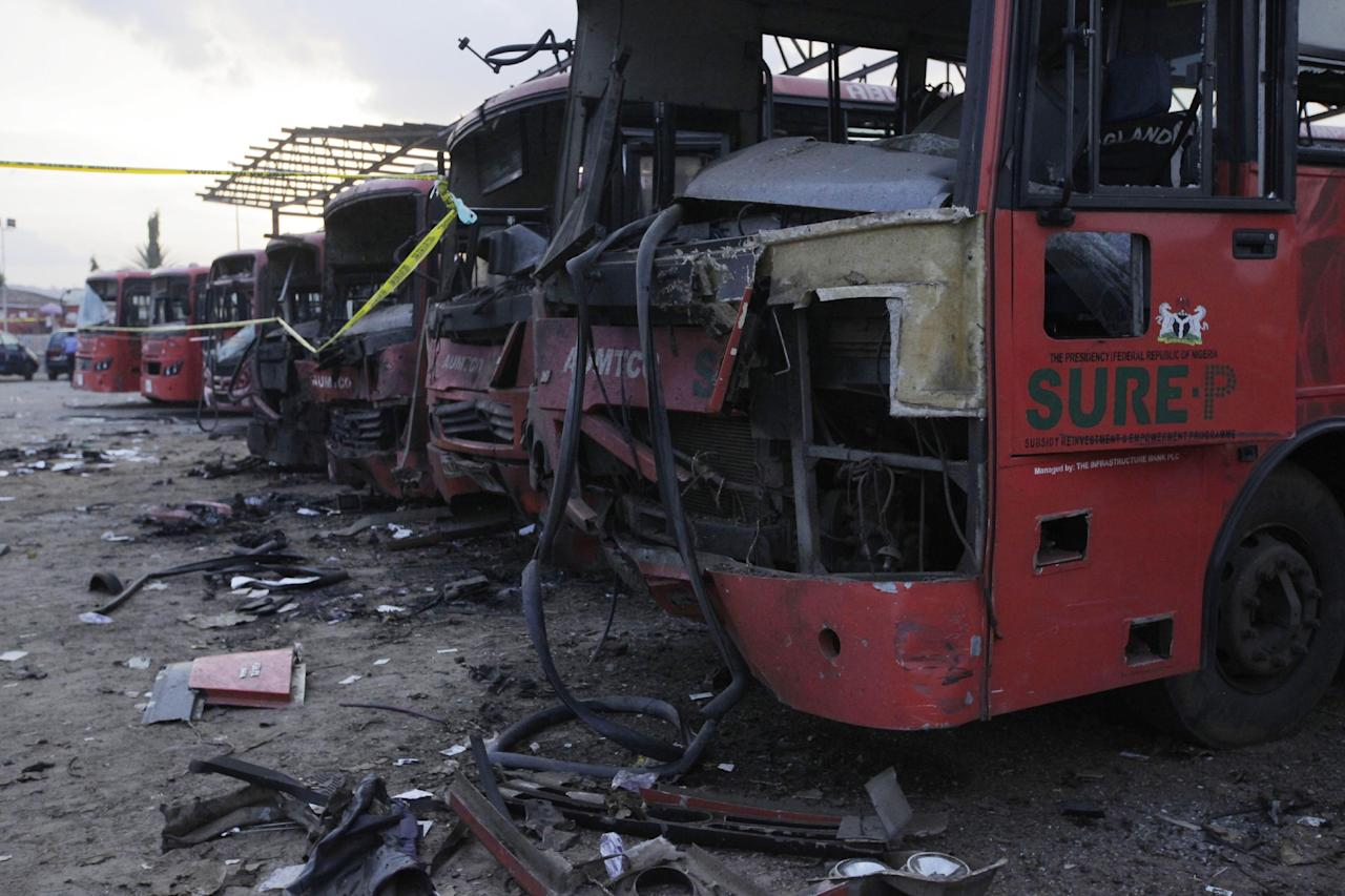 Damaged buses are seen at the scene of an explosion at a bus park in Abuja, Nigeria, Monday, April. 14, 2014. Suspected Islamic militants struck at the heart of Nigeria with a massive rush-hour explosion at a bus station Monday that killed 71, with the toll expected to rise in the deadliest attack yet on the nation's capital. (AP Photo/ Sunday Alamba)