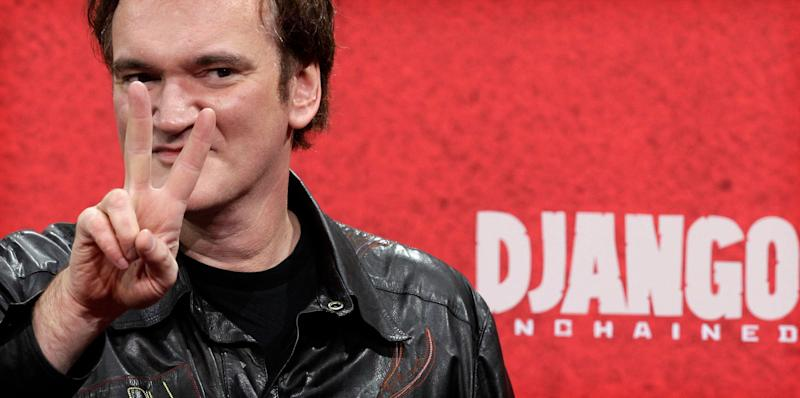 """Film director Quentin Tarantino flashes a victory sign as he arrives on the red carpet for the German premiere for his latest movie """"Django Unchained"""" in Berlin January 8, 2013. The movie opens in German cinemas on January 17. REUTERS/Tobias Schwarz (GERMANY - Tags: ENTERTAINMENT HEADSHOT)"""