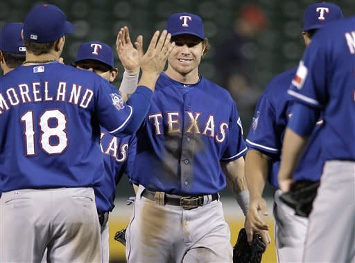 Texas Rangers' Josh Hamilton, center, high-fives teammates after the second baseball game of a doubleheader against the Baltimore Orioles in Baltimore, Thursday, May 10, 2012. Texas won 7-3. (AP Photo/Patrick Semansky)