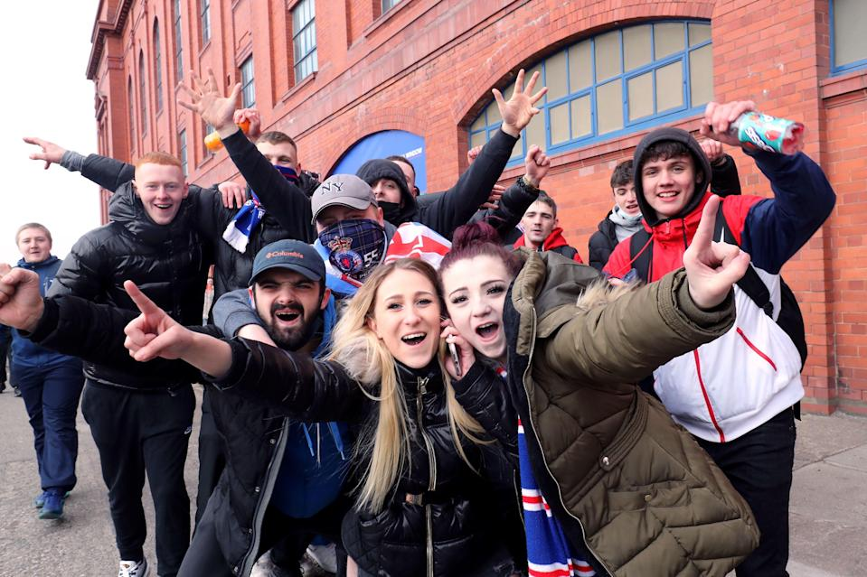 <p>Rangers fans gathered in large numbers outside the Ibrox Stadium </p> (PA)