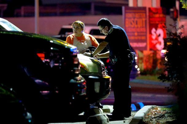 PHOTO: A San Diego Police officer question witnesses just outside a Church's Chicken eatery after a shooting that left one dead and two injured, Oct. 6, 2019. (Nelvin C. Cepeda/San Diego Union-Tribune via Newscom)