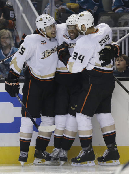 Anaheim Ducks' Emerson Etem, left, celebrates his goal with teammates Devante Smith-Pelly, center, and Daniel Winnik (34) during the second period of a preseason NHL hockey game against the San Jose Sharks on Friday, Sept. 20, 2013, in San Jose, Calif. (AP Photo/Marcio Jose Sanchez)