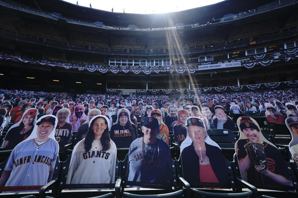 FILE - Cardboard cutouts of fans sit in seats at Oracle Park before a baseball game between the San Francisco Giants and the San Diego Padres in San Francisco, in this Tuesday, July 28, 2020, file photo. Fake sounds simulated clapping or yelling. Sometimes it worked. Sometimes it didn't.(AP Photo/Jeff Chiu, File)