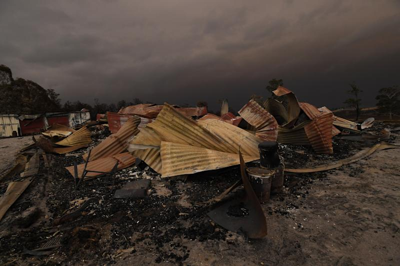 Remains of a burnt-out property that was impacted by a blaze in late December is seen at Bruthen South, Victoria, Saturday, January 4, 2019. Twenty-two people are dead, 21 more are missing and more than 1500 homes have been destroyed as fires burned through over six-million hectares of land. (AAP Image/James Ross)