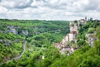 """<p><strong>Population:</strong> 628</p> <p>We're big fans of <a href=""""https://www.cntraveler.com/gallery/9-most-beautiful-hilltop-towns-in-italy?mbid=synd_yahoo_rss"""" rel=""""nofollow noopener"""" target=""""_blank"""" data-ylk=""""slk:hilltop towns"""" class=""""link rapid-noclick-resp"""">hilltop towns</a> in general, but Rocamadour stands out with its spectacular views over the Alzou canyon. The one-street town is known for its cliffside collection of religious buildings, including Chapelle Notre Dame with its famous Black Madonna statue.</p>"""