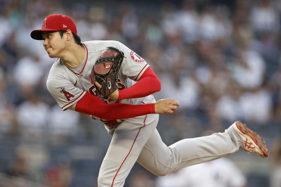 Los Angeles Angels' Shohei Ohtani follows through on a pitch during the first inning of the team's baseball game against the New York Yankees on Wednesday, June 30, 2021, in New York. (AP Photo/Adam Hunger)