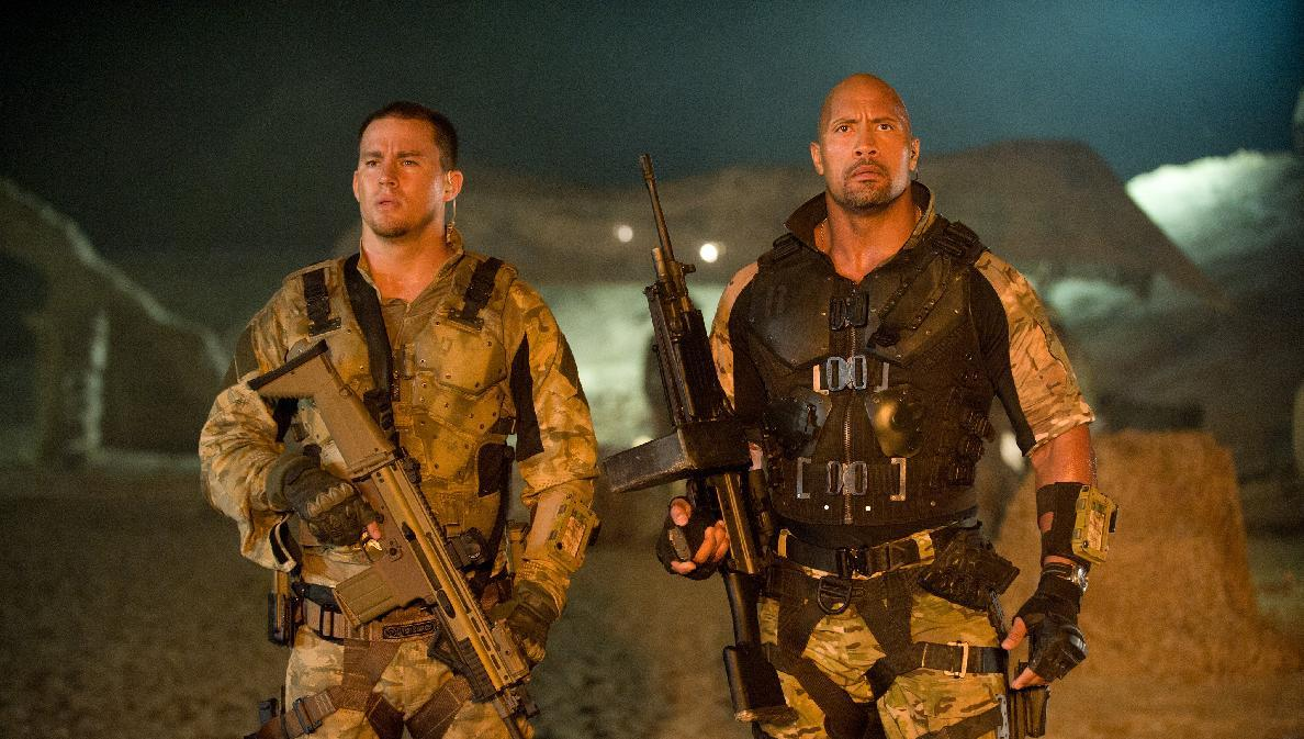 """In this film image released by Paramount Pictures, Channing Tatum, left, and Dwayne Johnson are shown in a scene from """"G.I. Joe: Retaliation."""" (AP Photo/Paramount Pictures, Jaimie Trueblood)"""