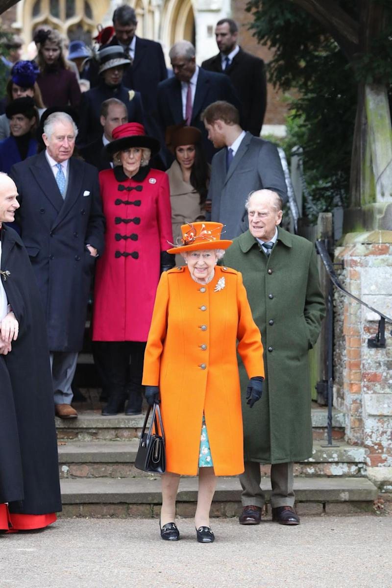 The Queen wore an orange suit at Sandringham on Christmas Day. Photo: Getty Images