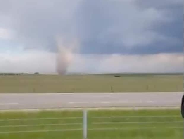 A possible tornado was seen near High River, Alta., on Saturday afternoon. (Submitted by Gwen Johnson/Twitter - image credit)