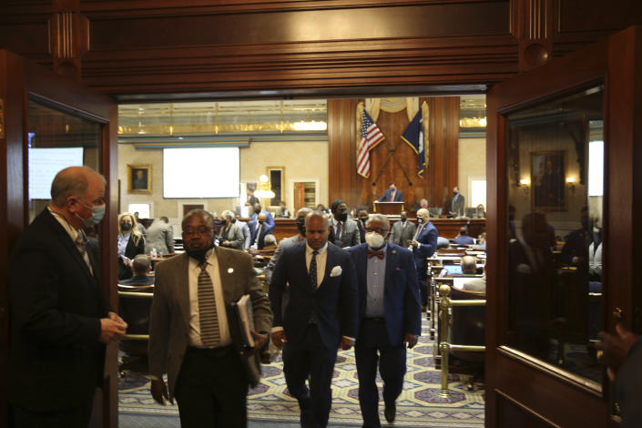 Black members of the South Carolina House walk out as an abortion bill is debated on Wednesday, Feb. 17, 2021 in Columbia, S.C. The House is expected to pass the bill that would ban nearly all abortions and send it to the governor's desk. (AP Photo/Jeffrey Collins)