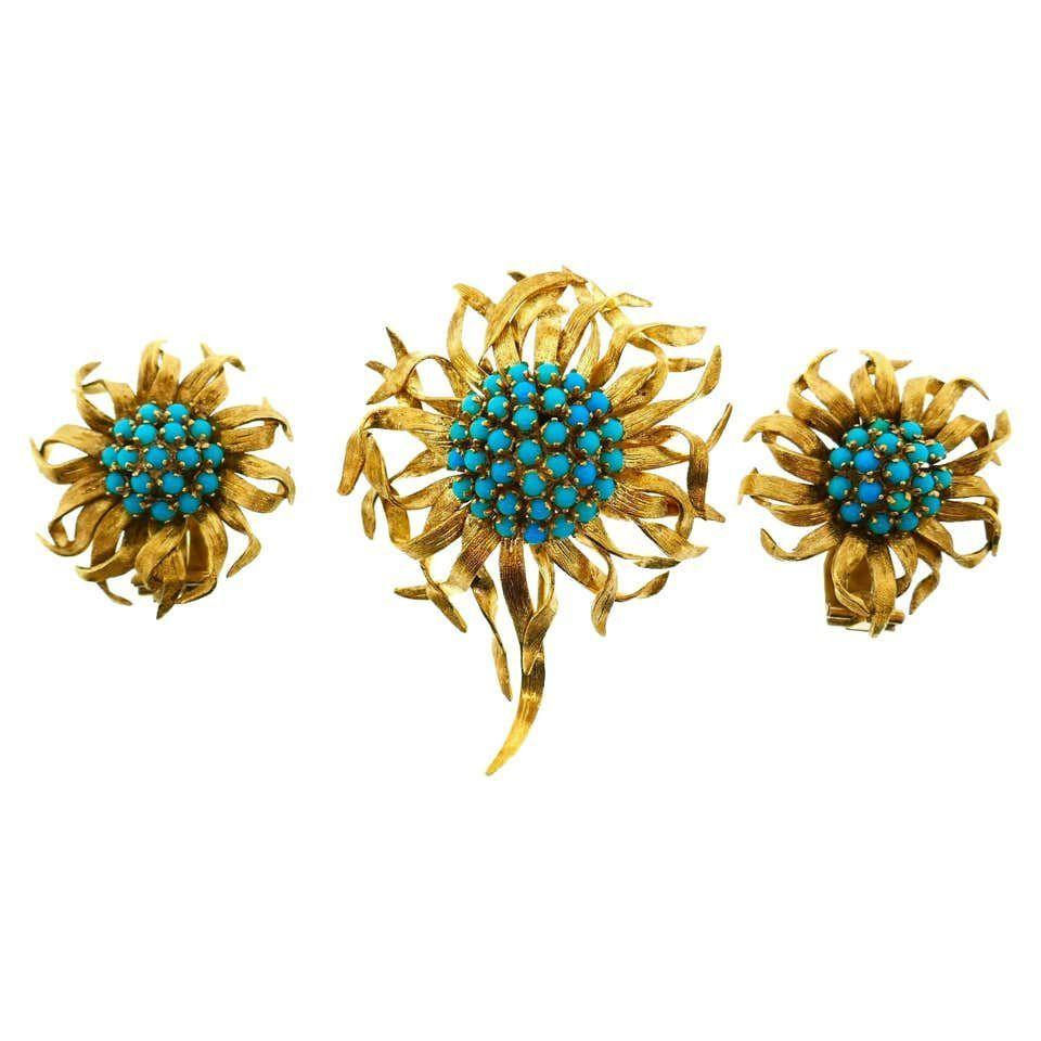 """<p><strong>Cartier</strong></p><p>1stdibs.com</p><p><a href=""""https://www.1stdibs.com/jewelry/earrings/clip-on-earrings/cartier-paris-18-karat-yellow-gold-turquoise-flower-brooch-earrings-set/id-j_5202072/"""" target=""""_blank"""">Discover</a></p><p>This whimsical and playful turquoise floral-inspired brooch-and-earring pair was created during the 1940s at the Paris branch of <a href=""""https://www.cartier.com"""" target=""""_blank"""">Cartier</a>. Pieces created during this decade are rather rare, making this set even more desirable. </p>"""