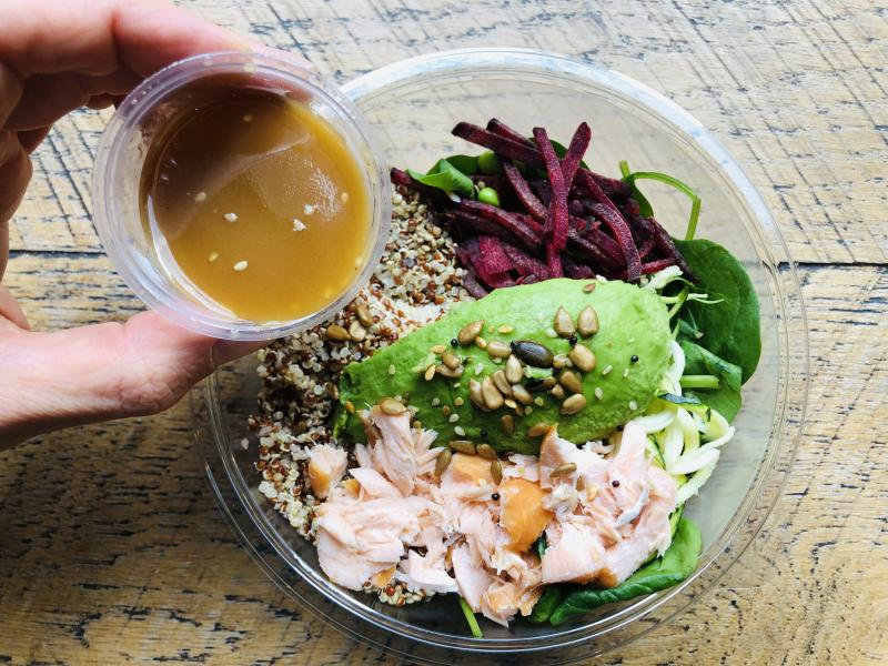 Ginger dressing added to a salad of smoked salmon, spinach, avocado and quinoa. (Photo: Getty Images)