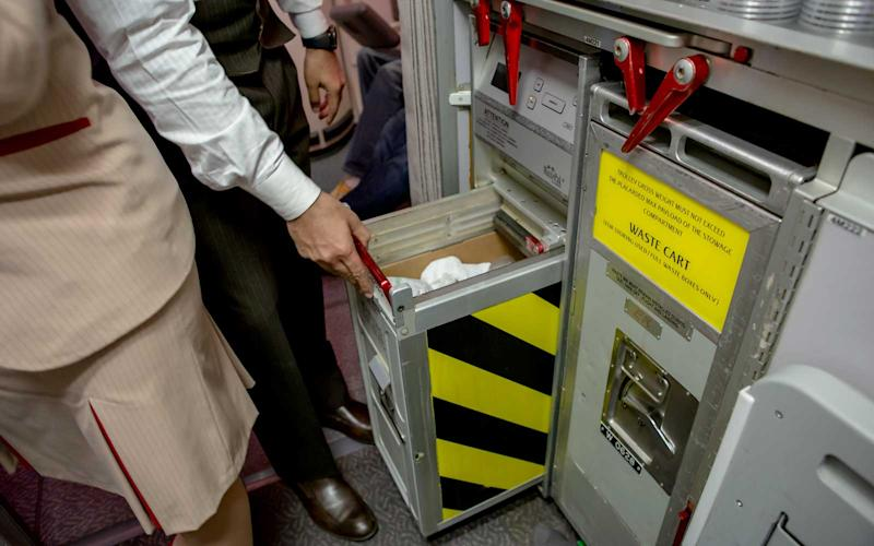 Emirates has a compacting system that allows for cabin crew to dispose of waste on flights in a cleanly manner. | Talia Avakian