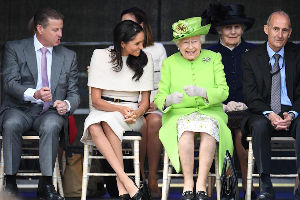 Meghan Markle and the Queen during their tour of Cheshire. [Photo: Getty]