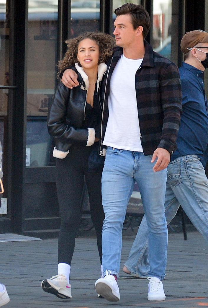 <p>Tyler Cameron and Camila Kendra step out with Cameron's brother Ryan in N.Y.C.'s West Village on Thursday.</p>