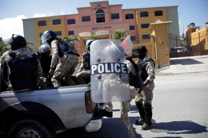 Haitian National Police guard a hotel designated as a quarantine facility for the coronavirus disease (COVID-19) in Port-au-Prince