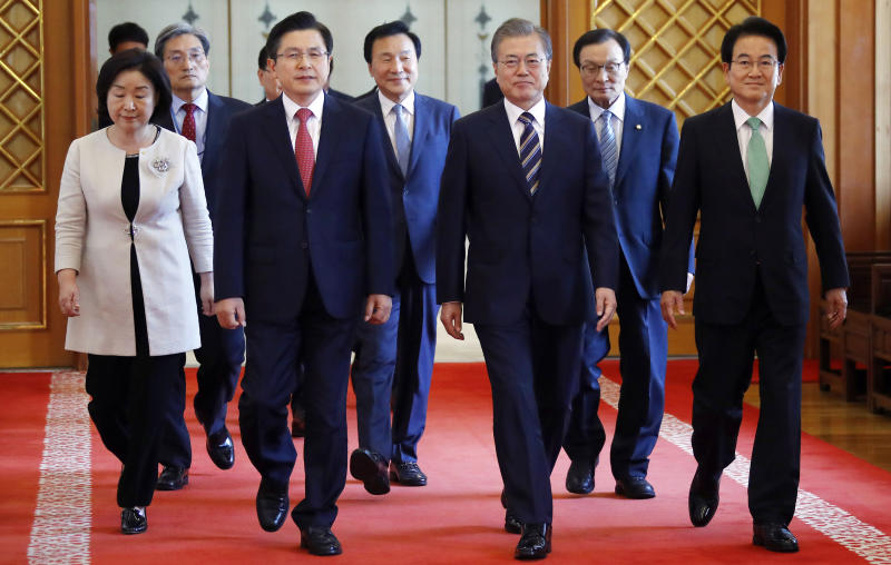 South Korean President Moon Jae-in, third from right, walks with ruling and opposition party leaders to attend a meeting to talk about an ongoing South Korea-Japan trade conflict at the presidential Blue House in Seoul, South Korea, Thursday, July 18, 2019. (Bee Jae-man/Yonhap via AP)
