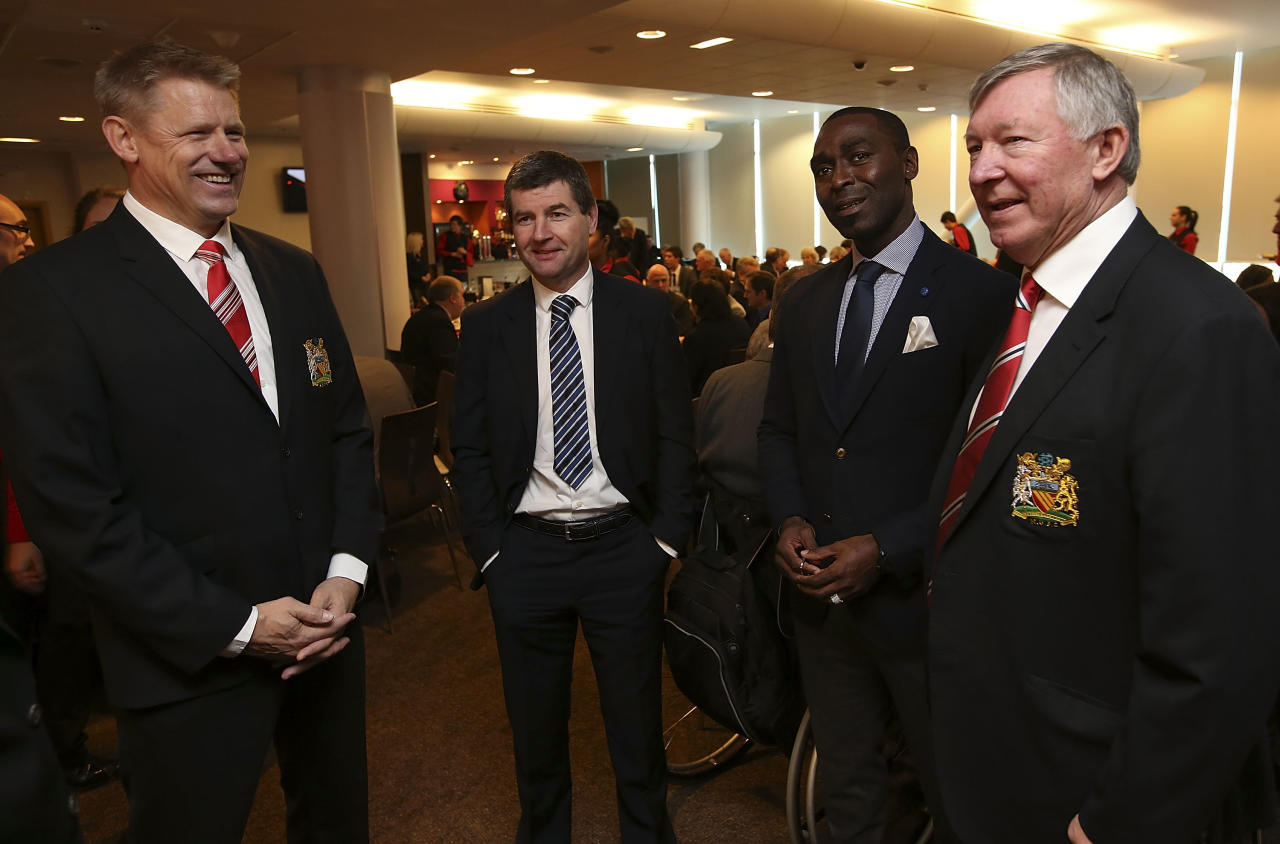MANCHESTER, ENGLAND - NOVEMBER 23:  Former players Peter Schmeichel, Denis Irwin and Andrew Cole talk with Sir Alex Ferguson after the unveiling of a statue of Manager Sir Alex Ferguson of Manchester United at Old Trafford on November 23, 2012 in Manchester, England.  (Photo by John Peters/Man Utd via Getty Images)