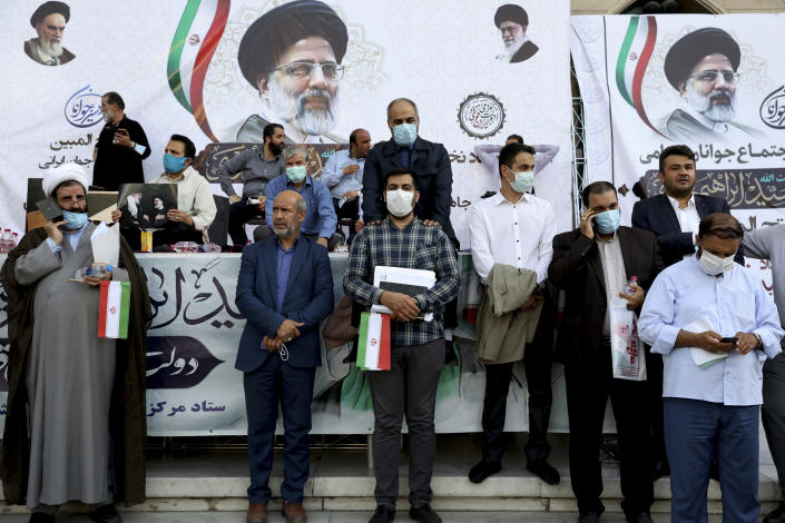 Supporters of presidential candidate Ebrahim Raisi attend a rally in Tehran, Iran, Wednesday, June 16, 2021. Iran's clerical vetting committee has allowed just seven candidates for the Friday, June 18, ballot, nixing prominent reformists and key allies of President Hassan Rouhani. The presumed front-runner has become Ebrahim Raisi, the country's hard-line judiciary chief who is closely aligned with Supreme Leader Ayatollah Ali Khamenei. (AP Photo/Ebrahim Noroozi)
