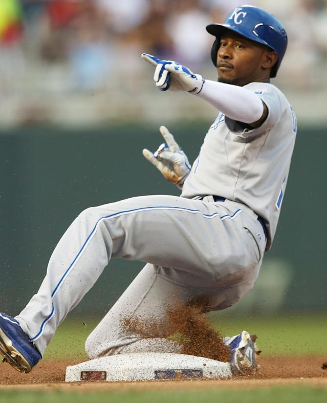 Kansas City Royals' Jarrod Dyson arrives with a triple off Minnesota Twins pitcher Ricky Nolasco in the third inning of a baseball game, Friday, Aug. 15, 2014 , in Minneapolis. (AP Photo/Jim Mone)