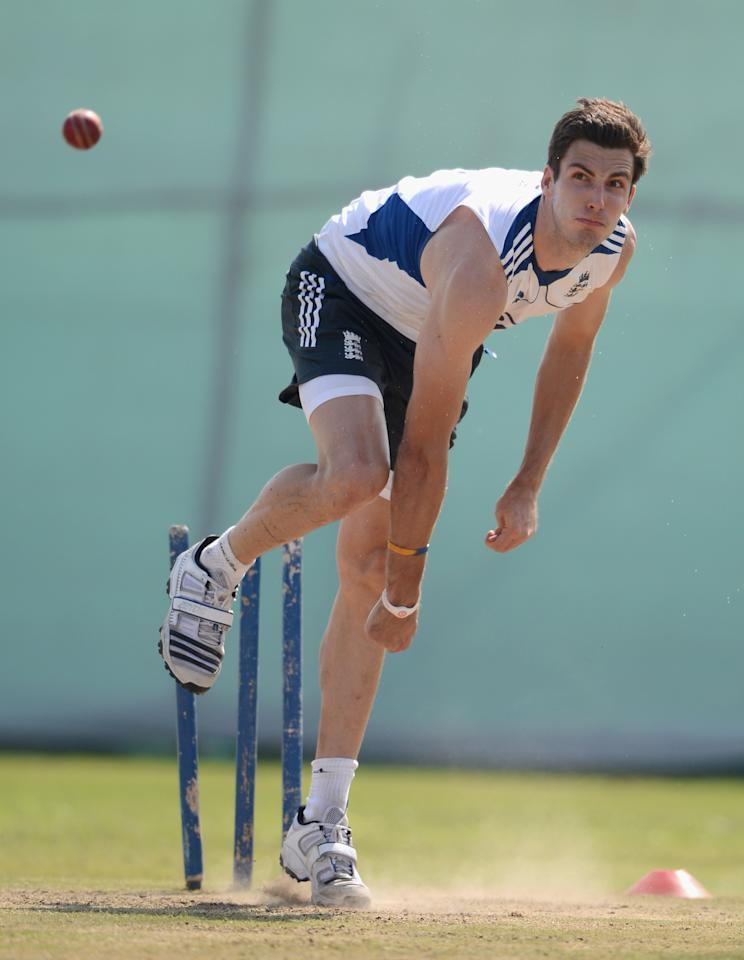 AHMEDABAD, INDIA - NOVEMBER 11:  Steven Finn of England bowls in the nets during day four of the tour match between England and Haryana at Sardar Patel Stadium ground B on November 11, 2012 in Ahmedabad, India.  (Photo by Gareth Copley/Getty Images)