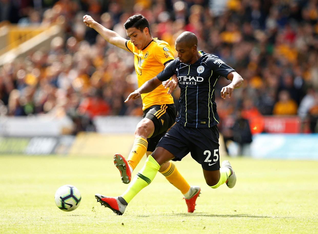 Raul Jimenez battles for possession with City's Fernandinho at Molineux