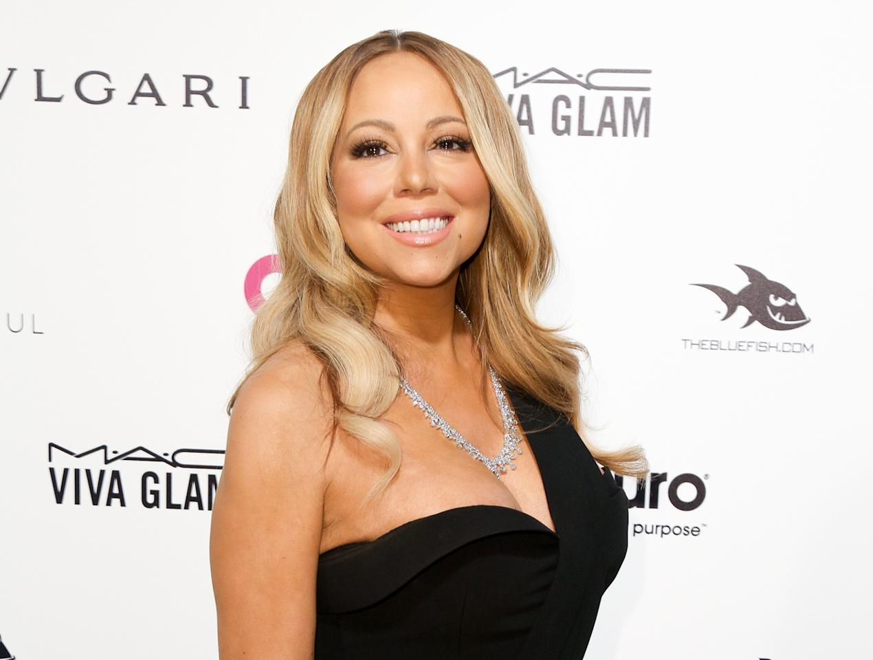 "FILE - In this Feb. 28, 2016 file photo, Mariah Carey arrives at the 2016 Elton John AIDS Foundation Oscar Viewing Party in West Hollywood, Calif. Carey will produce and star in ""Mariah's World,"" an E! channel docu-series that will follow her on tour and as she plans her wedding to Australian businessman James Packer. (Photo by Rich Fury/Invision/AP, File)"