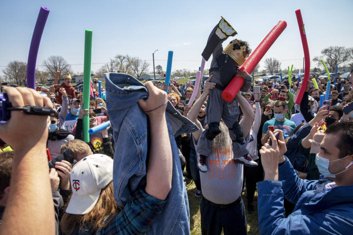 Lincoln native four-year-old Joshua Vinson Jr., top right, is lifted into the air after being declared the ultimate Josh after the Josh fight took place in an open green space at Air Park on Saturday, April 24, 2021, in Lincoln, Neb.. What started as a mid-pandemic joke took on life Saturday, as a mixed bag of individuals sharing only their name came to battle it out. The winner was to be declared the rightful owner of the name. (Kenneth Ferriera/Lincoln Journal Star via AP)