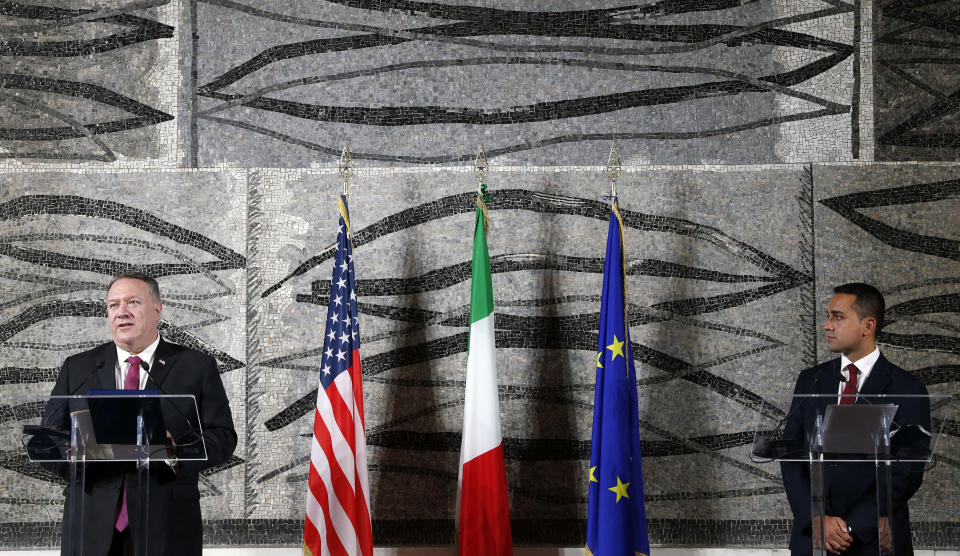 U.S. Secretary of State Mike Pompeo, left, speaks at a joint news conference with Italian Foreign Minister Luigi Di Maio in Rome, Wednesday, Sept. 30, 2020. Pompeo is in Italy as part of his six-day trip to Southern Europe. (Guglielmo Mangiapane/Pool Photo via AP)