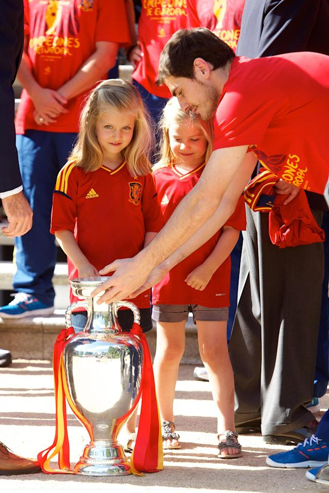 MADRID, SPAIN - JULY 02: Iker Casillas of Spain places the UEFA EURO 2012 trophy in front of Princess Leonor of Spain (L) and Princess Sofia of Spain at Zarzuela Palace on July 2, 2012 in Madrid, Spain. (Photo by Pool/Getty Images)