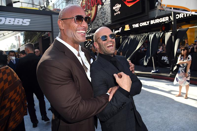 "HOLLYWOOD, CALIFORNIA - JULY 13: (L-R) Dwayne Johnson and Jason Statham arrives at the premiere of Universal Pictures' ""Fast & Furious Presents: Hobbs & Shaw"" at Dolby Theatre on July 13, 2019 in Hollywood, California. (Photo by Kevin Winter/Getty Images)"