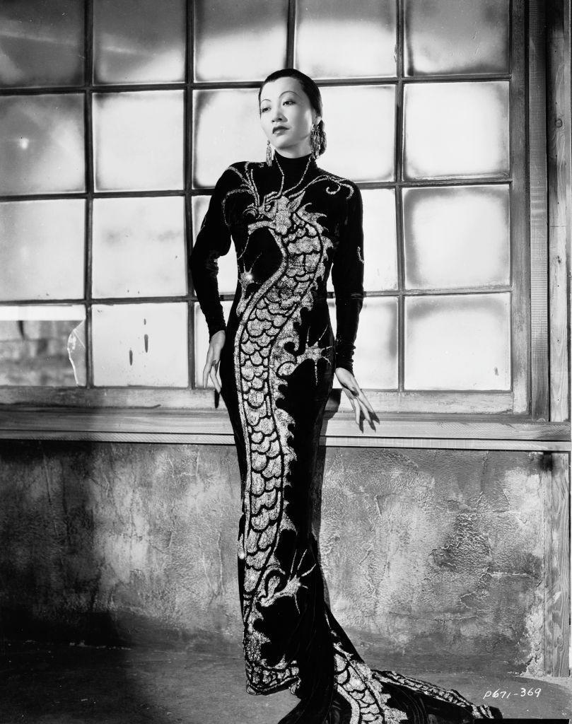 <p>In a publicity image for <em>Limehouse Blues</em>, Wong wore a dress featuring a large dragon motif. The crime movie, set in London, was not a commercial success and featured Wong's costar, George Raft, in yellowface. </p>