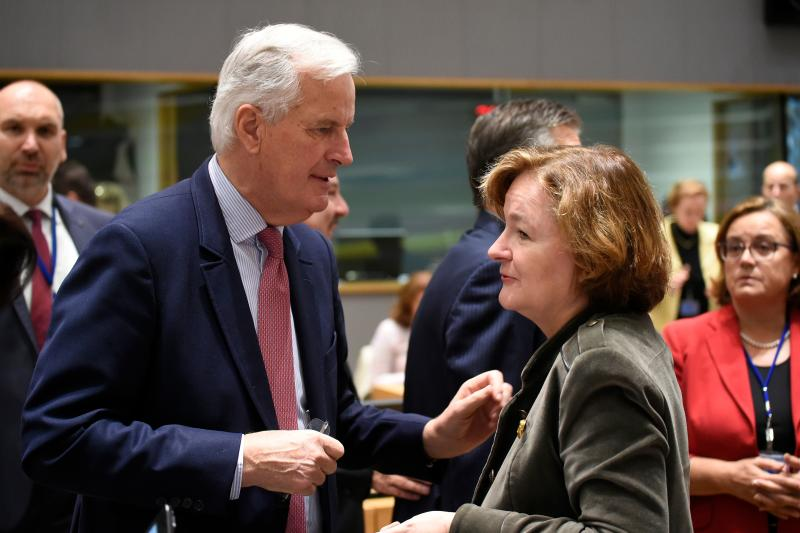 French Europe minister Nathalie Loiseau in conversation with compatriot Michel Barnier the EU's chief Brexit negotiator More