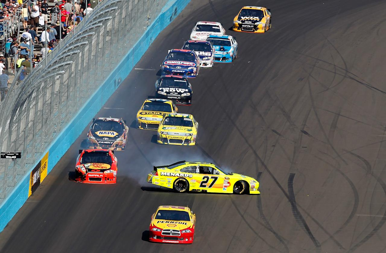 AVONDALE, AZ - MARCH 04:  Paul Menard, driver of the #27 Menards/ Tarkett Chevrolet, spins out during the NASCAR Sprint Cup Series SUBWAY Fresh Fit 500 at Phoenix International Raceway on March 4, 2012 in Avondale, Arizona.  (Photo by Tyler Barrick/Getty Images for NASCAR)