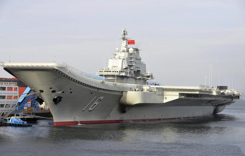 FILE - In this undated file photo released by China's Xinhua News Agency, China's aircraft carrier Liaoning berths in a port of China. China says it was routine combat drills, yet the deployment of the aircraft carrier Liaoning's battle group in the Western Pacific and into the South China Sea has made neighbors jittery about Beijing's flexing its muscles. (Li Tang/Xinhua via AP, File)