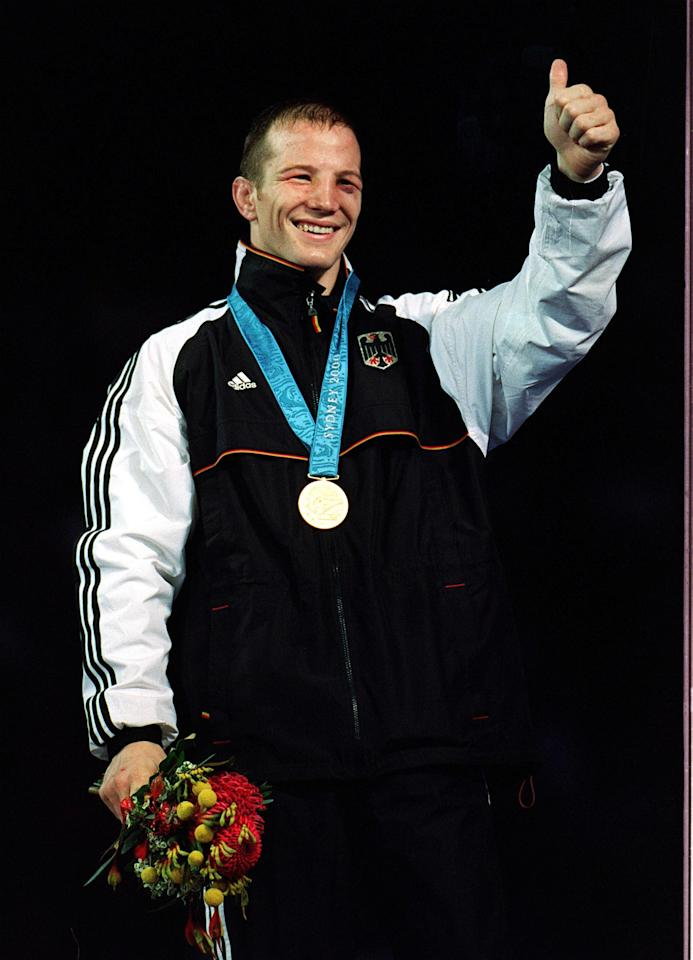 30 Sep 2000:  Alexander Leipold of Germany celebrates winning the Freestyle wrestling gold medal in the 76 kilogram category held at the Sydney Convention and Exhibition Centre in Darling Harbour during the Sydney 2000 Olympic Games in Sydney, Australia.Mandatory Credit: Doug Pensinger/ALLSPORT