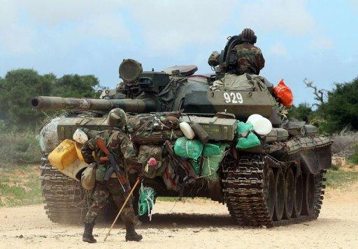 African Union troops move just outside of the Somali capital Mogadishu