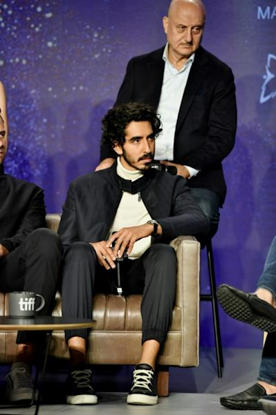 "TORONTO: Dev Patel (L) and Anupam Kher speak onstage at ""Hotel Mumbai"" Press Conference during 2018 Toronto International Film Festival"