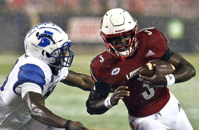 Indiana State linebacker Jonas Griffith (46) attempts to grab Louisville quarterback Malik Cunningham (3) during the second half of an NCAA college football game Saturday, Sept. 8, 2018, in Louisville, Ky. (AP Photo/Timothy D. Easley)