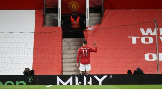 Manchester United's Mason Greenwood celebrates scoring his side's first goal against Liverpool