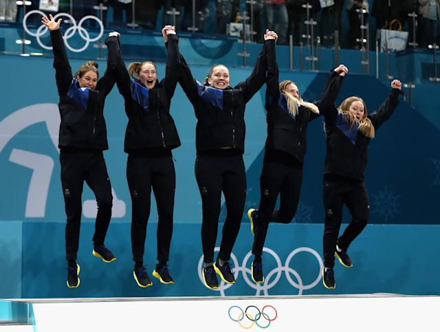 <p>Winners of the gold medal, Jennie Waahlin, Sofia Mabergs, Agnes Knochenhauer, Sara McManus and Anna Hasselborg of Sweden celebrate on the podium following the Women's Gold Medal Game between Sweden and Korea on day sixteen of the PyeongChang 2018 Winter Olympic Games at Gangneung Curling Centre on February 25, 2018 in Gangneung, South Korea. (Photo by Ronald Martinez/Getty Images) </p>