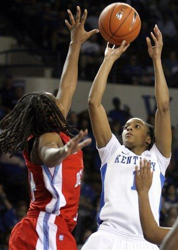 Kentucky's A'dia Mathies, right, shoots under pressure from Delaware State's Keyanna Tate during the first half of an NCAA college basketball game at Memorial Coliseum in Lexington, Ky., Saturday, Nov. 10, 2012. (AP Photo/James Crisp)