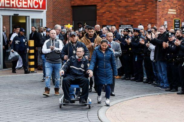 PHOTO: A police officer injured in a shooting the previous evening is released at Lincoln Hospital, Feb. 9, 2020, in New York. (John Minchillo/AP, FILE)