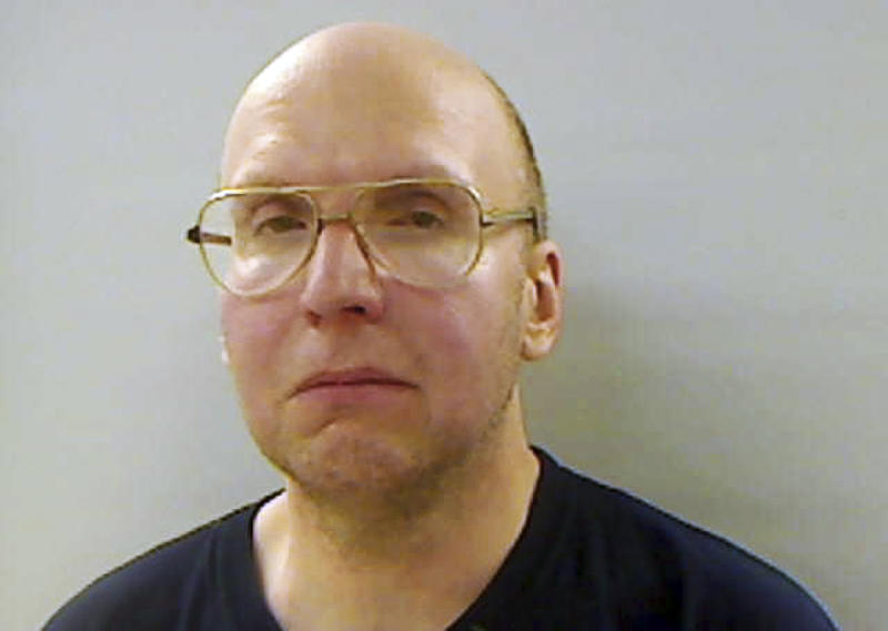 This April 2013 booking photo released by the Kennebec County Sheriff's Office in Augusta, Maine, shows Christopher Knight, arrested Thursday, April 4, 2013, while stealing food from a camp in Rome, Maine.  Authorities said Knight, known as the North Pond Hermit and who lived for 27 years in the woods of central Maine, may be responsible for more than 1,000 burglaries.  (AP Photo/Kennebec County Sheriff's Office)
