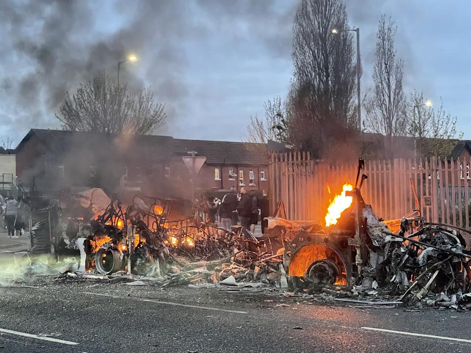 The wreckage of a Translink Metrobus on fire on the Shankill Road in Belfast during further unrest. Picture date: Wednesday April 7, 2021. (Photo by Liam McBurney/PA Images via Getty Images)
