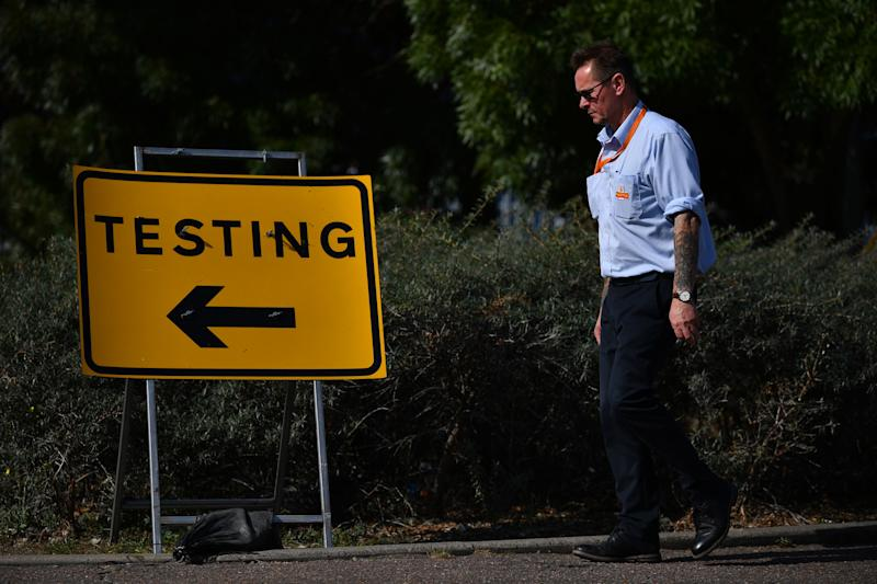 Pedestrians walk past a sign for a Covid-19 test centre in Southend-on-Sea, east of London on September 19, 2020. (Photo by Ben STANSALL / AFP) (Photo by BEN STANSALL/AFP via Getty Images)