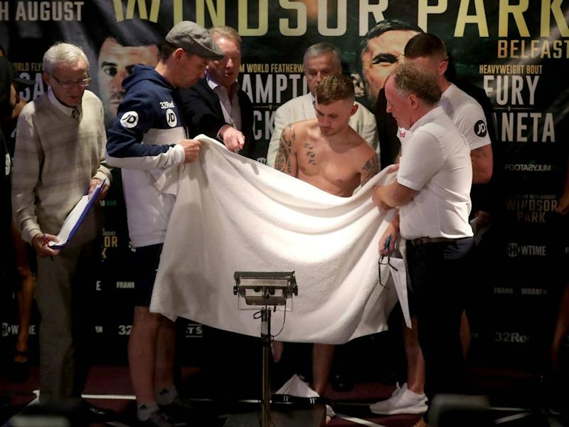 Carl Frampton struggled to make weight as he had to get completely naked at the weigh-in (PA)