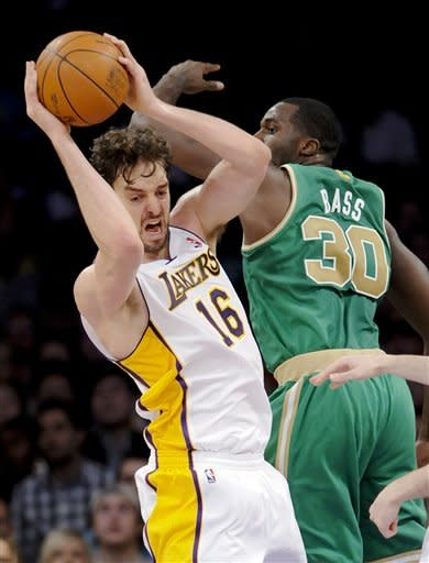 Los Angeles Lakers forward Pau Gasol (16), of Spain, grabs the rebound over Boston Celtics forward Brandon Bass (30) in the first half of an NBA basketball game, Sunday, March 11, 2012, in Los Angeles. (AP Photo/Gus Ruelas)