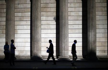 FILE PHOTO - People are silhouetted on a sunny morning as they walk past the columns of the Bank of England in the City of London, May 19, 2014.REUTERS/Andrew Winning